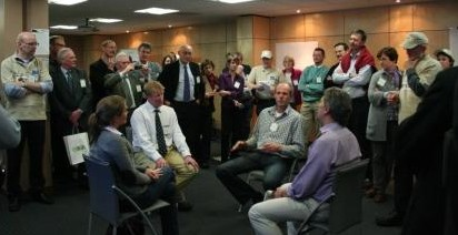 Patrick taking part in a 'goldfish bowl' seminar discussion